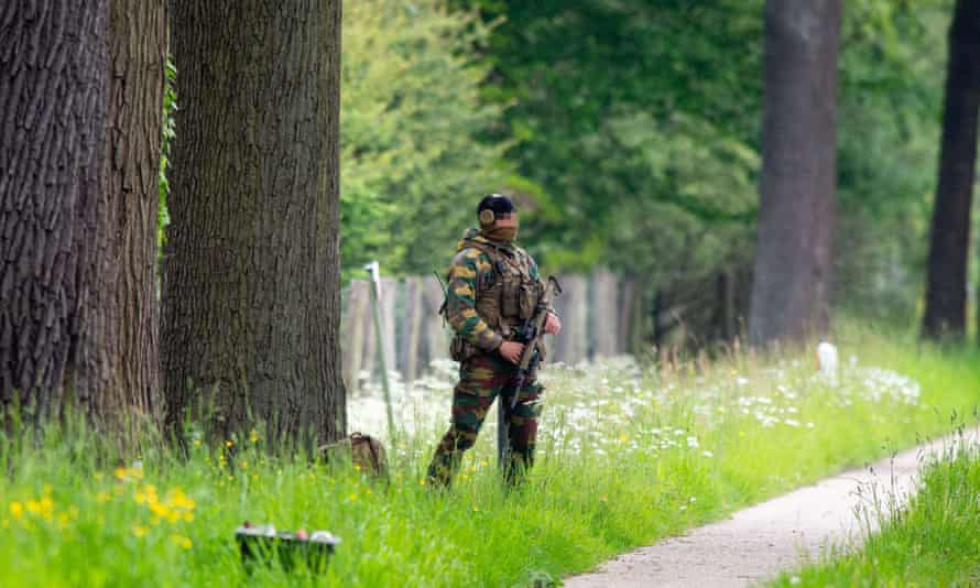 A solider stands guard at the national park in Dilsen-Stokkem