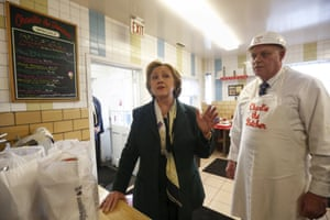 Hillary Clinton speaks with the media during a campaign stop at Charlie the Butcher in Buffalo, New York.