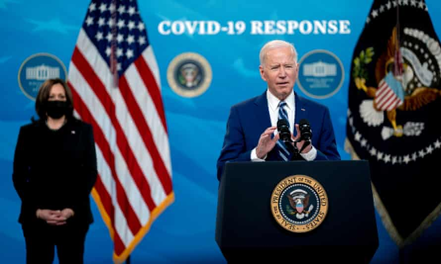 Kamala Harris listens as Joe Biden speaks on the state of the Covid-19 vaccine in the White House on Monday.