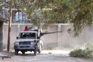 A GNA fighter operates a heavy gun mounted in the back of pick-up truck
