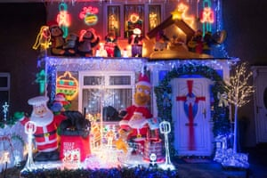 Festive sparkle illuminates a house in Stockdale Road in Dagenham, Essex. The display helps to raise money for Saint Francis Hospice, a local charity