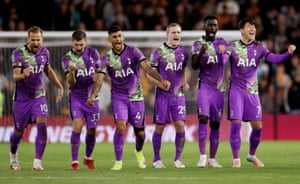 Spurs players celebrate after winning the penalty shoot out.