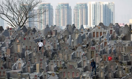 People clean the tombs of their deceased relatives in Diamond Hill cemetery in Hong Kong. Spaces are rarely available in cemeteries such as these.