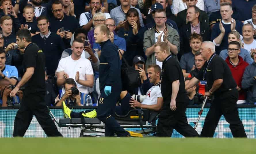 Tottenham's Harry Kane is wheeled off the pitch against Sunderland.