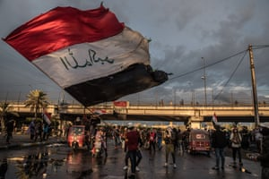A man waving the Iraqi flag during a symbolic funeral march for a protester killed in clashes with security forces the previous day. Baghdad, 21 January 2020