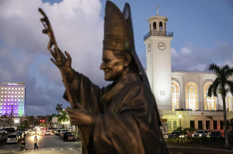 A statue of Pope John Paul II stands outside the island's main cathedral, Dulce Nombre de Maria Cathedral-Basilica, Hagatna, Guam.