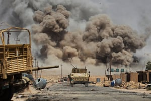 Smoke billows as Iraqi forces advance towards Al-Ayadiah village in the campaign to retake Tal Afar from Islamic State