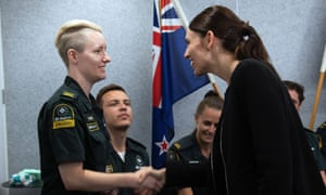 Ardern shakes hands with ambulance and emergency services crew at an event on Wednesday.