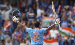 India's Rohit Sharma celebrates after scoring a century.