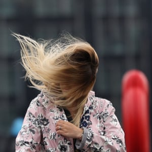 he wind catches a woman's hair in London