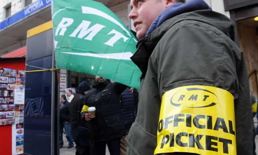 File photo of RMT union members picket at Victoria Station. The union's Mick Cash described plans for a 24-hour tube service as a 'shambles'.