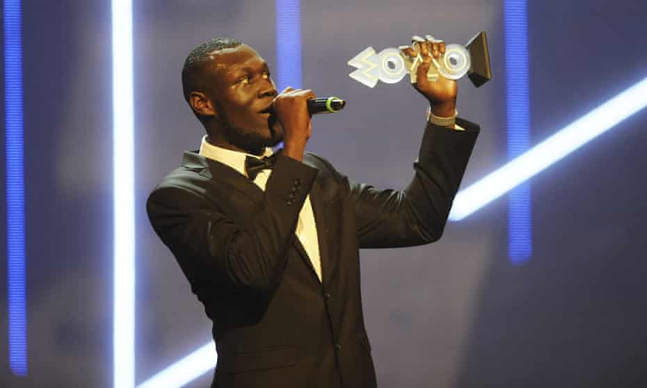 Stormzy accepts his award for best grime act during the Mobo awards in November 2015