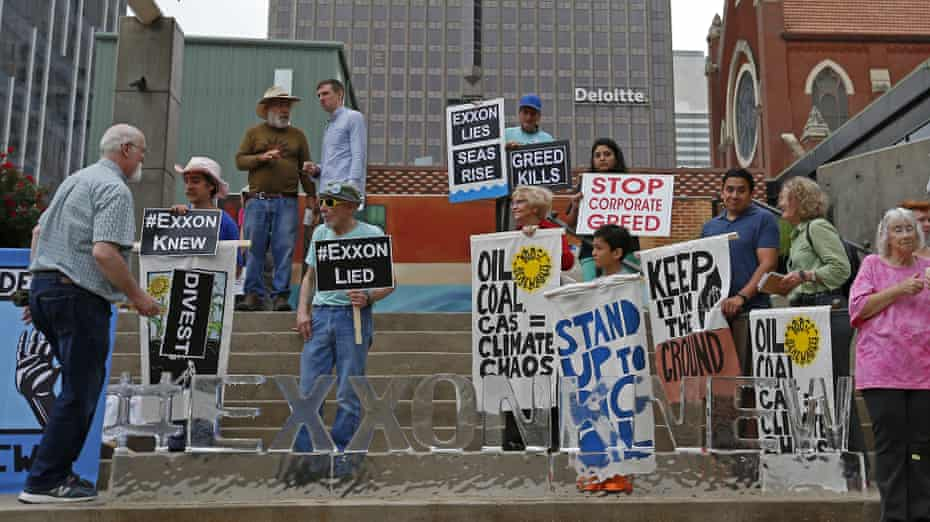 Protesters outside the Morton H Meyerson Symphony Center in Dallas, where the ExxonMobil AGM took place.