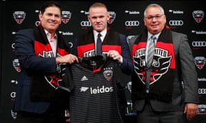DC United managing partner and CEO Jason Levien (left) and DC United general manager Dave Kasper pose with Wayne Rooney at the forward's unveiling