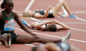 Laura Muir lies exhausted on the track after failing to break the British women's mile record at the London Stadium.