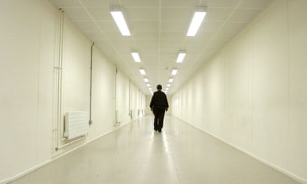A security officer walks down one of the corridors of Yarl's Wood immigration removal centre, Bedford.