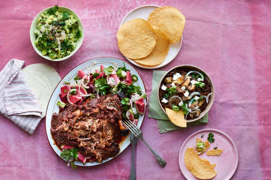 Tacos Padre at home: (clockwise from right) mushroom tostada, pasilla adobo and goat's cheese, lamb barbacoa with ancho adobo and radish salad, and guacamole with green salsa macha.