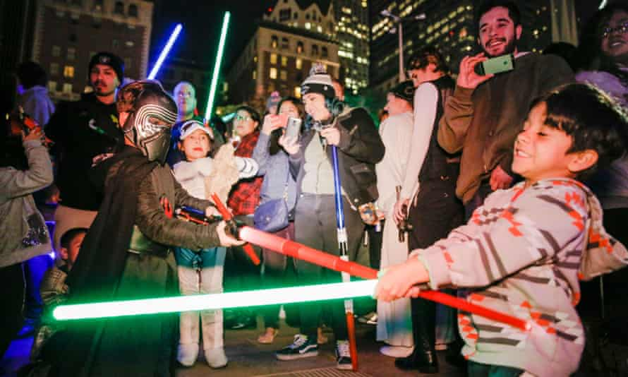 Star Wars fans in Los Angeles celebrate the release of The Force Awakens in US cinemas.