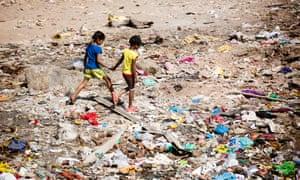 Children play on a wasteland in a Mumbai slum