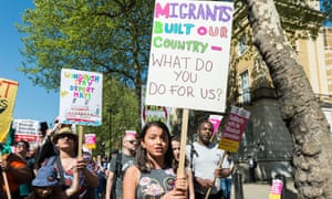 Protesters in London march against immigration policies.
