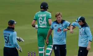 David Willey of England celebrates with captain Eoin Morgan after getting out Delany LBW.