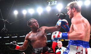 KSI (left) and Logan Paul exchange punches during their fight at Staples Center in Los Angeles