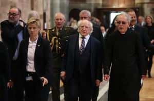 President of Ireland, Michael D. Higgins (centre), attends the service