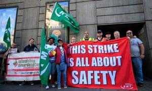 A picket line opposite Victoria Station in London, as hundreds of thousands of rail passengers face a week of travel chaos because of a five-day strike in an escalating dispute over the role of conductors.