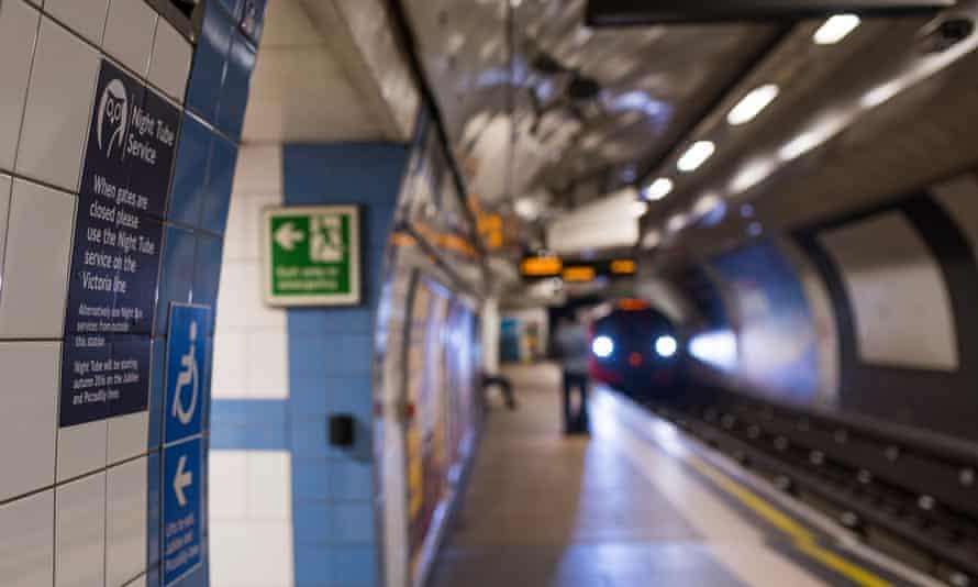 A night tube train pulls into a Victoria Line platform