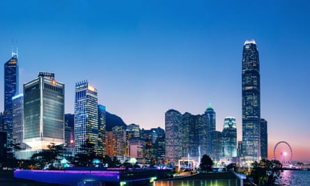 The iconic night view of the Central Business District in Hong Kong with contemporary skyscrapers along Victoria Harbour