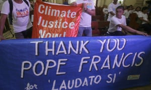 Environmental activists in the Philippines display a banner as they prepare to listen to speeches inside a church to coincide with Pope Francis' encyclical on climate change in June.