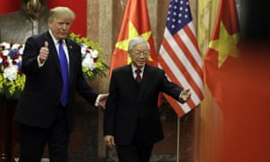 Donald Trump meets Vietnamese President Nguyen Phu Trong at the Presidential Palace in Hanoi.