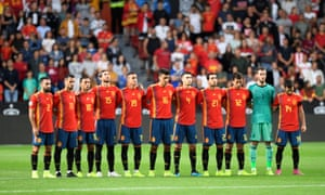 Spain observing a minute's silence before the game.