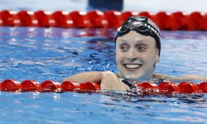 Katie Ledecky celebrates after breaking the world record to take gold.