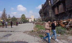Students at Mosul University library, which has suffered damage from ISIS.