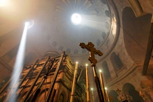 The ceremony of the Holy Light at the Church of the Holy Sepulchre in Jerusalem on Holy Saturday.