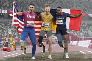 Germany's Markus Rehm (centre), the T64 long jump Paralympic champion, the silver medallist Dimitri Pavade (France, right) and the bronze medal winner Trenten Merrill of the USA.