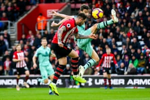Danny Ings of Southampton scores a headed goal to make it 1-0 as Laurent Koscielny of Arsenal challenges in vain