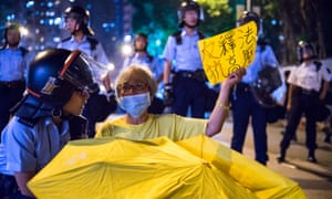 Protesters clash with police at China Liaison Office, where they occupied the road and were pepper sprayed.