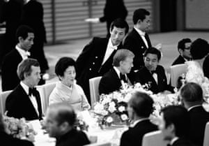 US President Jimmy Carter talks with Japanese Crown Prince Akihito in Tokyo as Canadian Prime Minister Joe Clark chats with Princess Chichibu at a banquet given by Emperor Hirohito for heads of state attending the economic summit in Tokyo in June 1979