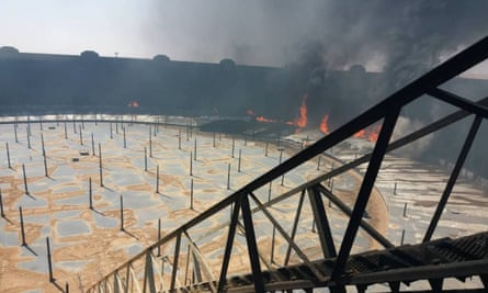 An image purporting to show an oil storage tank on fire at the Ras Lanuf terminal last week
