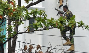Sri Lankan special forces climb a ladder during a raid at an address in Colombo.