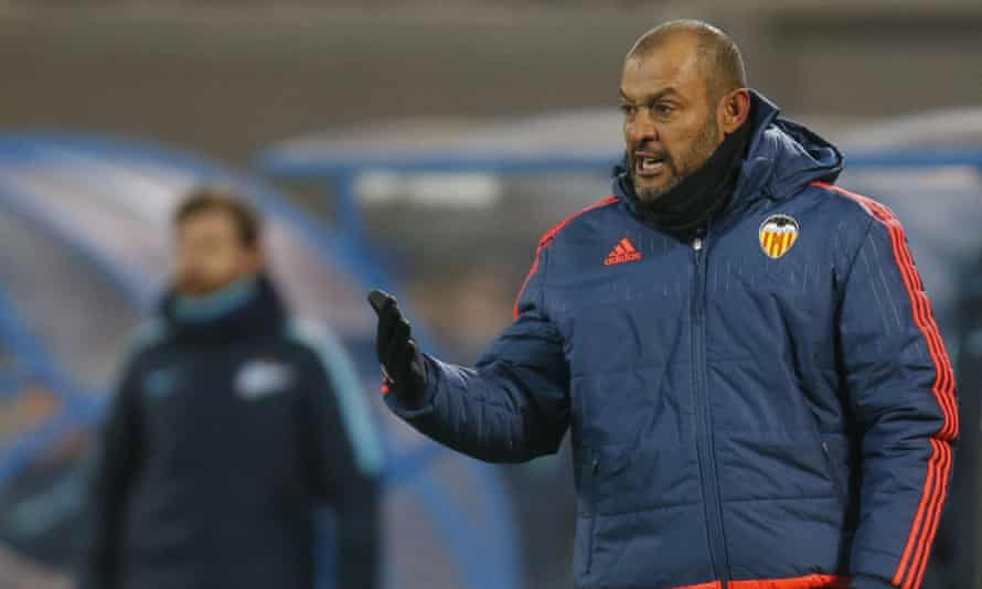 Nuno Espírito Santo during his time in charge at Valencia, with another former Porto coach, André Villas-Boas, in the background during a Champions League game against Zenit St Petersburg.