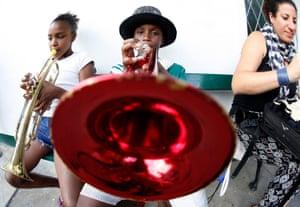 Rafael da Silva, 10, plays his red trumpet