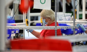 A GM employee works to make ventilators at the General Motors components holding plant in Kokomo, Indiana.