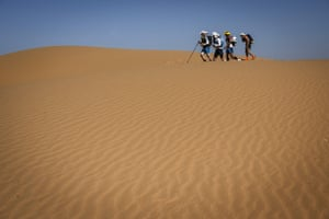 People compete in stage two of the 34th Marathon des Sables