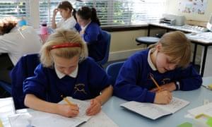Primary school children working in a classroom
