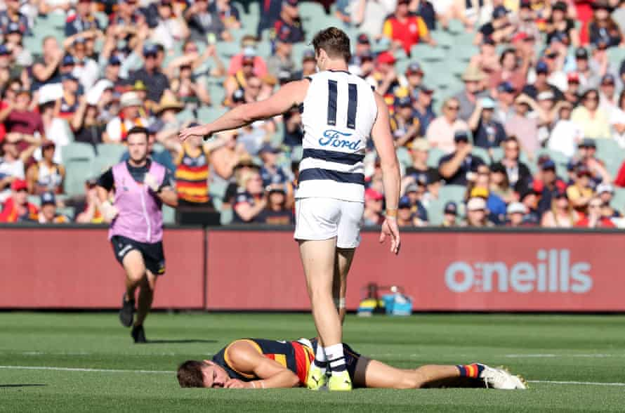 Jake Kelly of the Crows lays unconscious on the ground after a clash with Patrick Dangerfield.