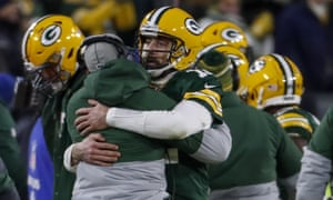 Green Bay Packers head coach Matt LaFleur celebrates a touchdown with Aaron Rodgers during the second half