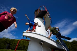 Young boys playing on the popular helter-skelter in the site's playground
